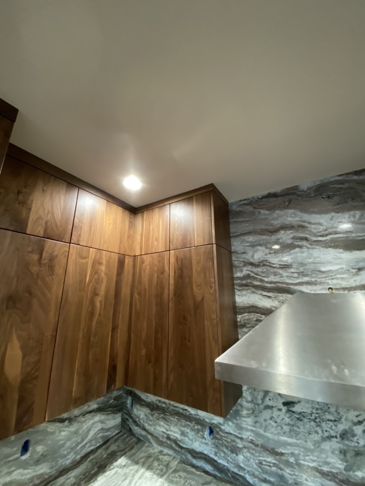 Correction of uneven ceiling for cabinetry installation