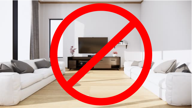 image of TV placed inconveniently to the side of sofas with red prohibited sign on top