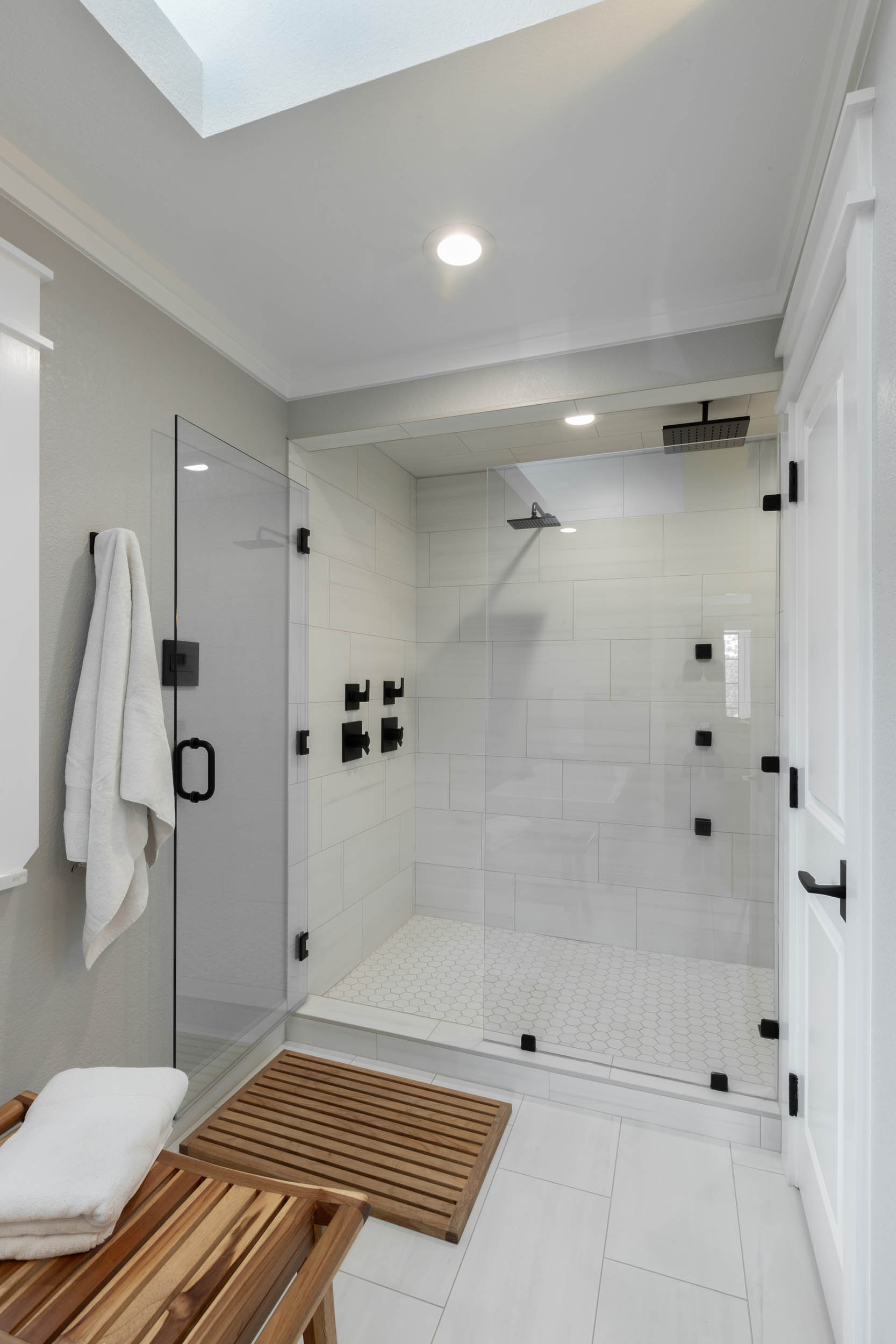 after picture of bathroom remodel with black and white