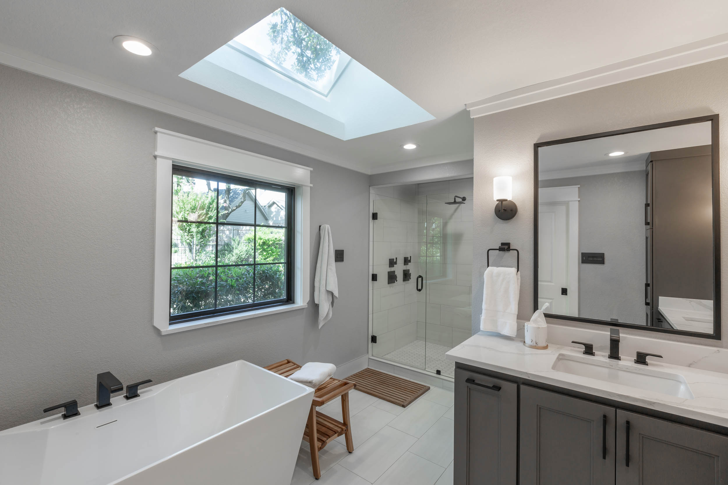 full bath remodel with black hardware and custom cabinetry