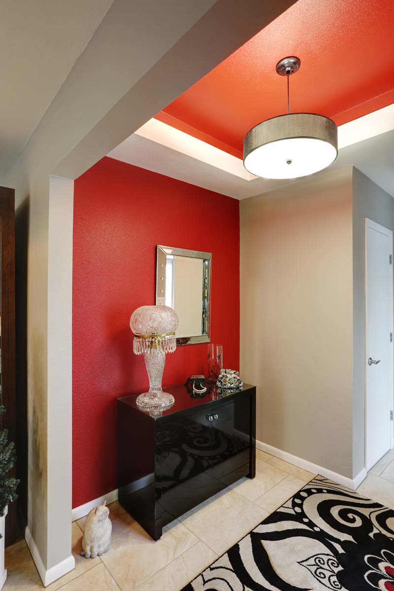 Accent wall with traditional style mixed with ecclectic red paint