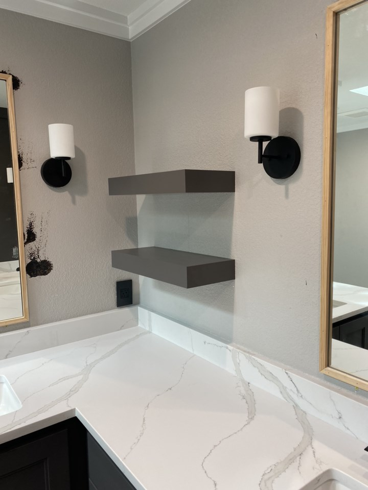 during picture of bathroom full remodel of lighting and shelving install