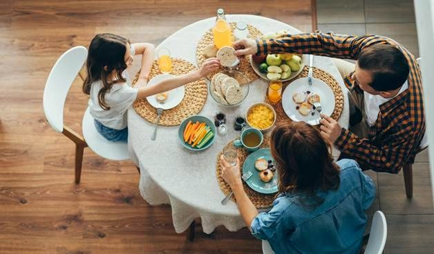 family eating healthy meal a home