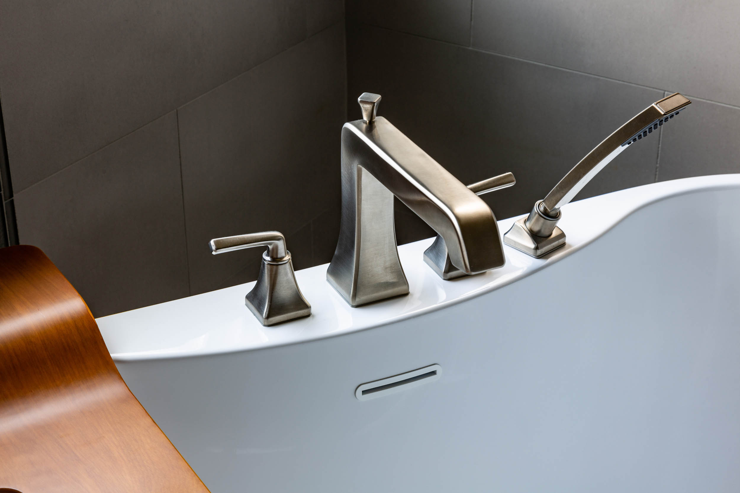 Luxurious bathtub in bathroom remodel with classy faucet hardware by
