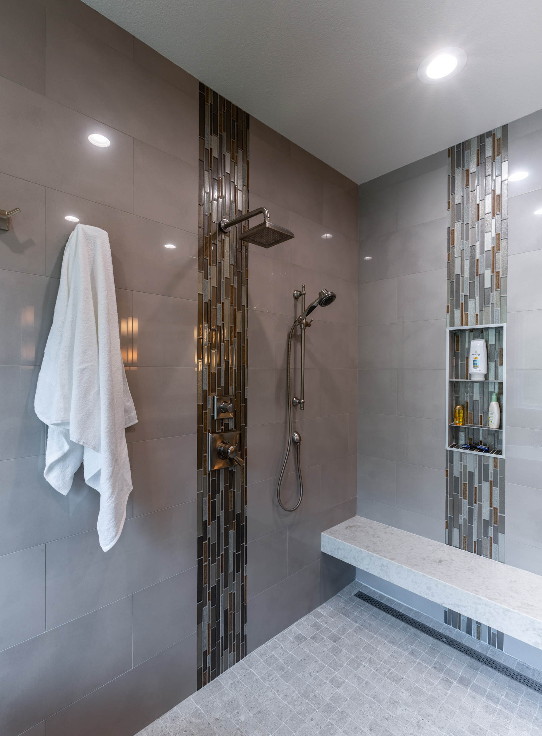 Master bath remodel with custom tile in seamless shower space