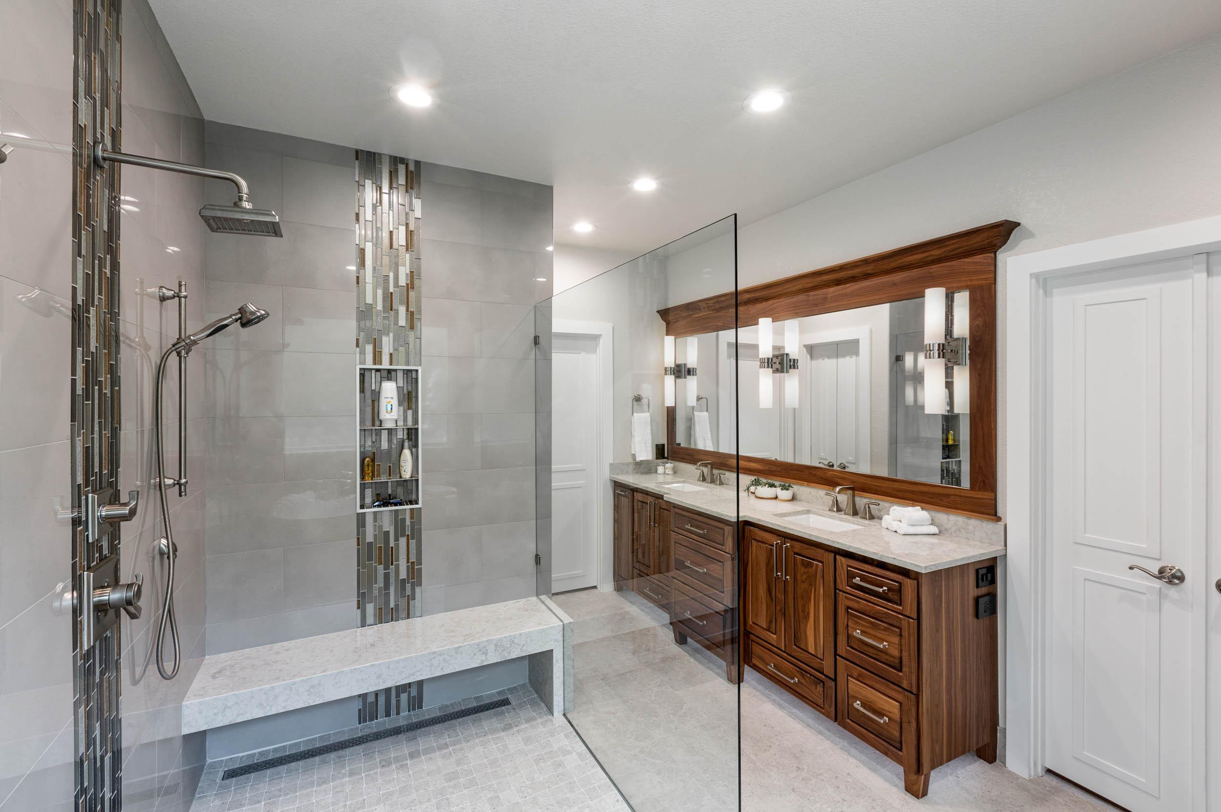 Walnut cabinets and glass door in custom bathroom design