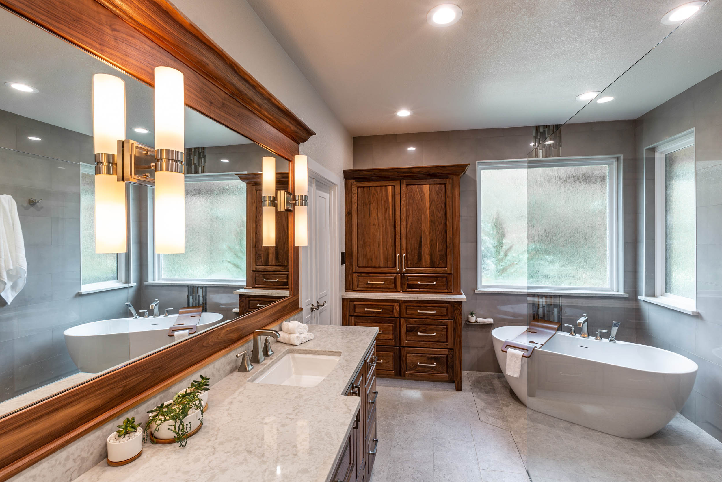 Walnut cabinets by DeWils Custom Cabinetry in bath remodel by Signature Home Services