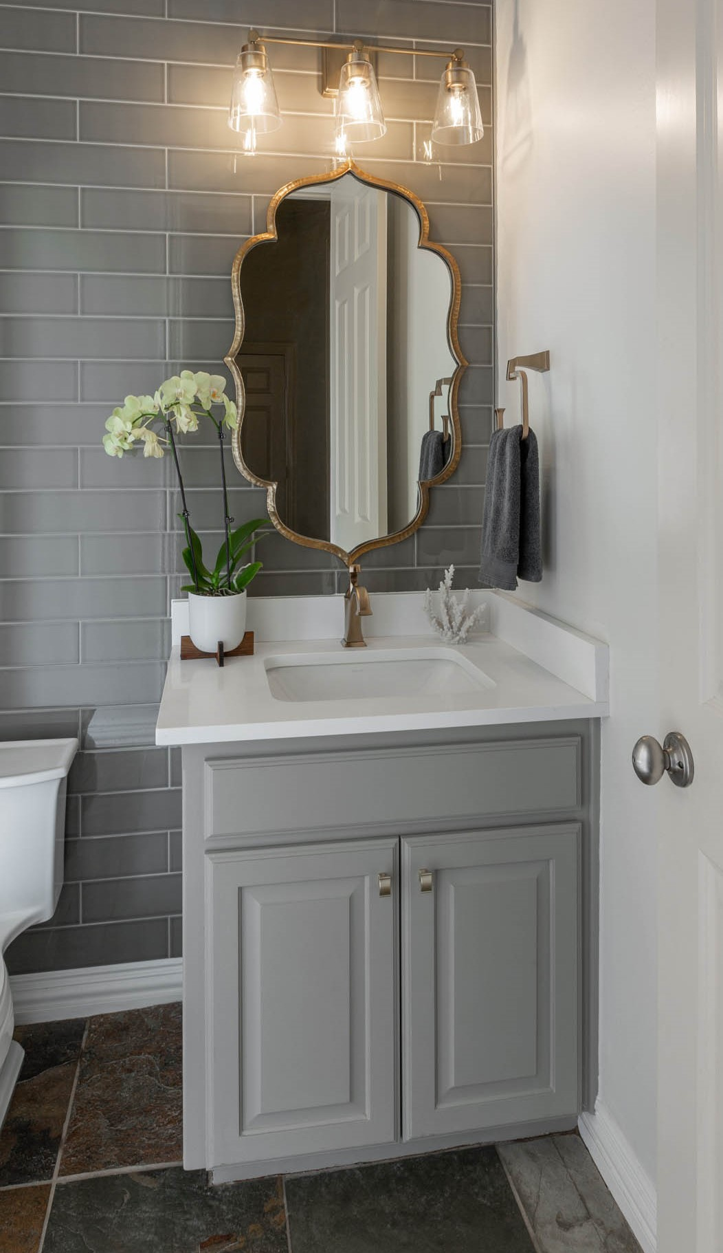 Custom mirror and new lights in bathroom remodel facelift