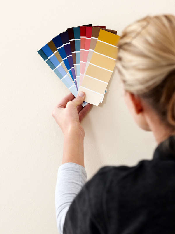 Woman selecting color for wall