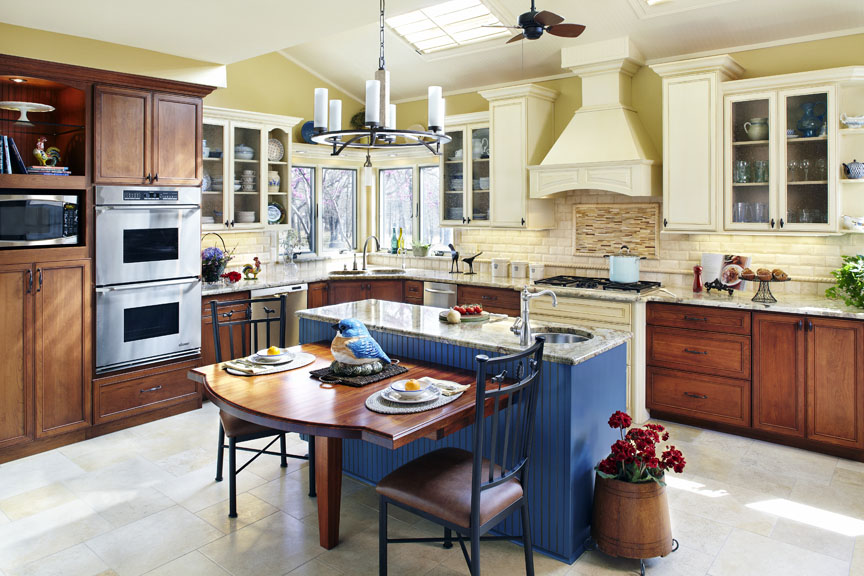 kitchen remodel with traditional look and side table for eating